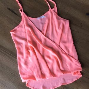Hot pink crop top with a criss cross front